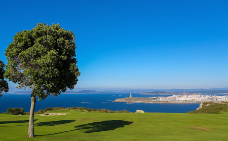 View from San Pedro mountain on the famous lighthouse or Hercules Tower of A Coruna, Galicia, Spain. This lighthouse is more than 1900 years old and is the oldest Roman lighthouse in use today. photo