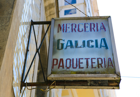 haberdashery: Old typical sign of a merceria (haberdashery) in the historic town Betanzos, Galicia, Spain.