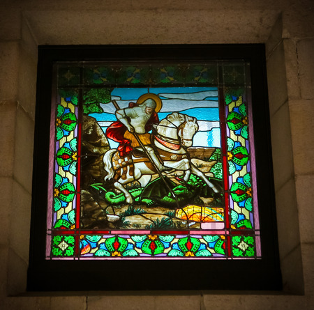 Glass window depicting Saint George at the Iglesia de San Jorge in A Coruna, Galicia, Spain. This window was created more than 200 years ago, no property release is required.