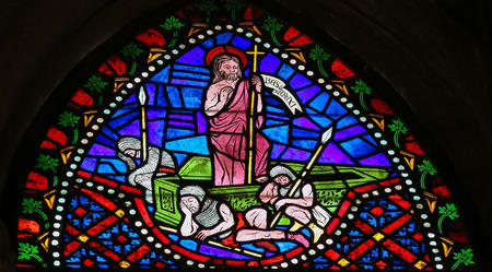 Stained glass window depicting Jesus rising from the grave in the cathedral of Leon, Castille and Leon, Spain. photo