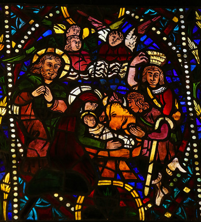 castille: Stained glass window depicting a Nativity Scene in the cathedral of Leon, Castille and Leon, Spain.