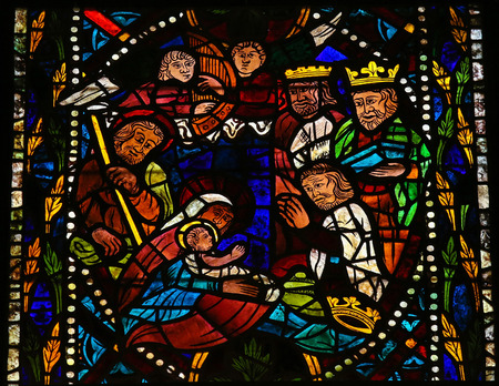 Stained glass window depicting a Nativity Scene with the Three Magi from the East in the cathedral of Leon, Castille and Leon, Spain. Archivio Fotografico