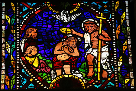 castille: Stained glass window depicting the Baptims of Jesus by Saint John  in the cathedral of Leon, Castille and Leon, Spain. Stock Photo
