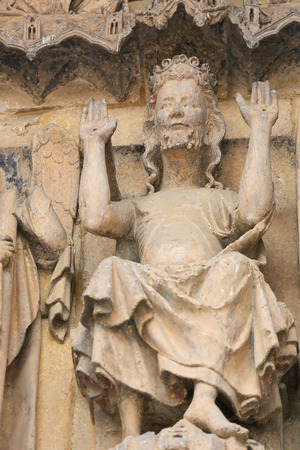 enthroned: Famous statue of Jesus above the entrance of Leon Cathedral in Leon, Castille and Leon, Spain.