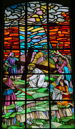 dolorosa: Stained glass window depicting Jesus on the Via Dolorosa with Veronica and her veil. It is located in the Santos Passos church in Guimaraes, Portugal.