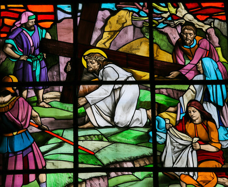 Stained glass window depicting Jesus on the Via Dolorosa with Veronica and her veil. It is located in the Santos Passos church in Guimaraes, Portugal.