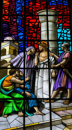 Stained glass window depicting Jesus accused before Pontius Pilate in the Santos Passos church in Guimaraes, Portugal. Editorial