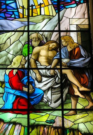 Stained glass window depicting Jesus carried to His Tomb in the Santos Passos church in Guimaraes, Portugal.
