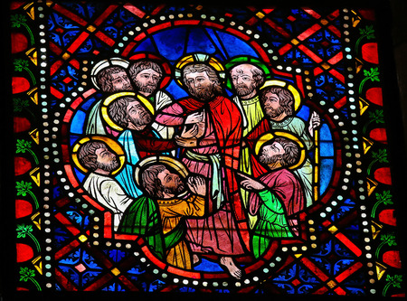 Stained glass window depicting Jesus and the apostles in the cathedral of Leon, Castille and Leon, Spain. The episode of Thomas the Apostle touching Jesus