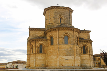 castille: FROMISTA, SPAIN - JULY 17, 2014: Famous Romanesque church of St Martin of Tours (11th Century) in Fromista, Castille and Leon, Spain. This church is considered to be the perfect Romanesque church. It is a famous stop on the Way of St James to Compostela. Editorial
