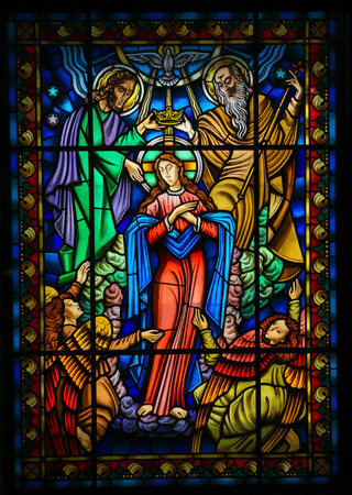 blessed trinity: Stained glass window depicting Mother Mary and the Holy Trinity in Ponte de Lima, a town in the Northern Minho region in Portugal.