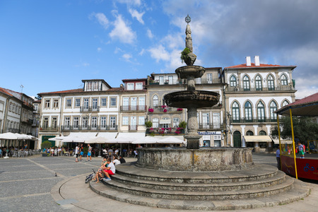 lima region: PONTE DE LIMA, PORTUGAL - AUGUST 3, 2014:  The main square Largo de Camoes with the 18th Century fountain in Ponte de Lima, a town in the Northern Minho region in Portugal.