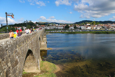 lima region: PONTE DE LIMA, PORTUGAL - AUGUST 3, 2014:  View on the Roman bridge at Ponte de Lima, a town in the Northern Minho region in Portugal.