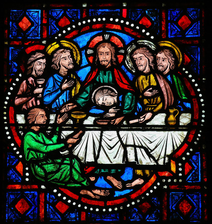 Stained glass window depicting Jesus and the Apostles at the Last Supper on Maundy Thursday in the Cathedral of Tours, France.