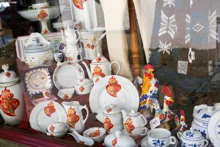 portugese: VIANA DO CASTELO, PORTUGAL - AUGUST 4, 2014: Typical tableware and Barcelos roosters in a Portugese souvenir shop in the center of Viana do Castelo, Portugal. Editorial