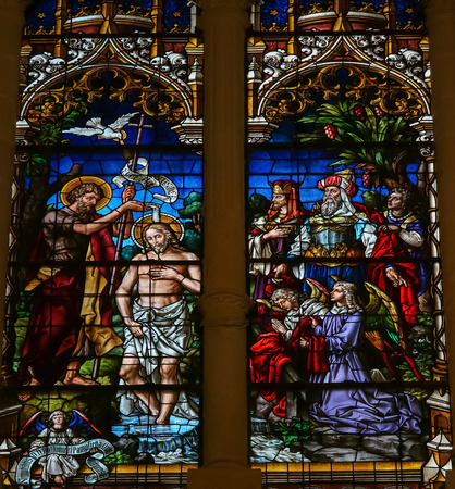 water stained: BURGOS, SPAIN - AUGUST 13, 2014: Stained glass window depicting the Baptism of Jesus by Saint John in the cathedral of Burgos, Castille, Spain. Editorial
