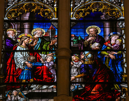 castille: BURGOS, SPAIN - AUGUST 13, 2014: Stained glass window depicting Jesus and children in the cathedral of Burgos, Castille, Spain. Editorial