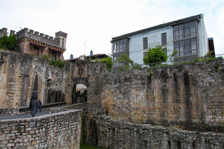 arma: HONDARRIBIA, SPAIN - MAY 26, 2014: City Wall at the Santa Maria Port Area in Hondarribia, a town in Gipuzkoa, Basque Country, Spain, near the French border.