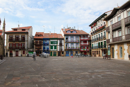 arma: HONDARRIBIA, SPAIN - MAY 27, 2014: Old houses at the Plaza Arma in Hondarribia, a town in Gipuzkoa, Basque Country, Spain, near the French border.