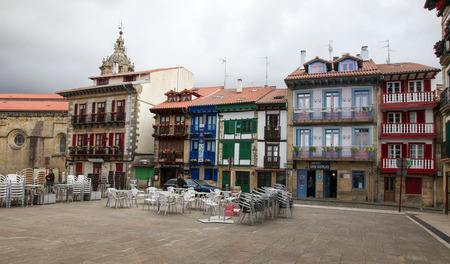 arma: HONDARRIBIA, SPAIN - MAY 26, 2014: Houses at the Plaza Arma in the Port Area in Hondarribia, a town in Gipuzkoa, Basque Country, Spain, near the French border.