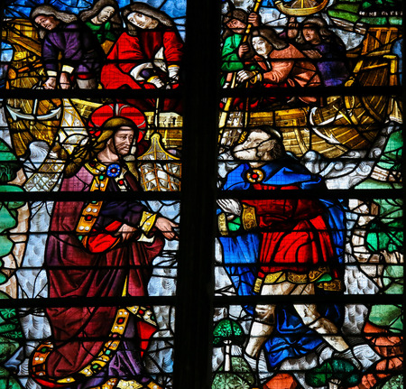 ROUEN, FRANCE - FEBRUARY 10, 2013: Stained glass window depicting Jesus calling Simon Petrus (Saint Peter) to become a fisher of men  in the Cathedral of Rouen, France.