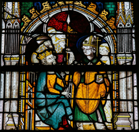 ROUEN, FRANCE - FEBRUARY 10, 2013: Stained glass window depicting a bishop and a king in the Cathedral of Rouen, France. Editorial