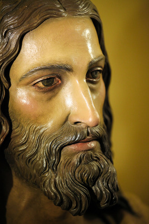 RONDA, SPAIN - DEC 1, 2013: Face of Jesus Christ, in the church of Ronda, Spain. This statue was created more than 100 years ago, no property release is required.