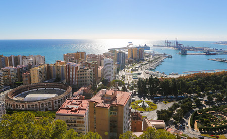 Panorama on the port of Malaga, Andalusia, Spain, with the famous bullring La Malagueta on the left. photo