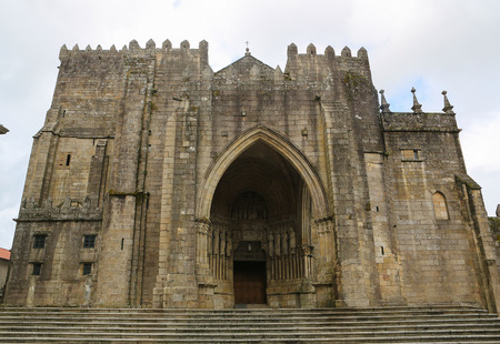 patrimony: Facade with entrance portal of the Romanesque Cathedral (11th-13th Century) of Saint Mary of Tui, Galicia, Spain. Stock Photo