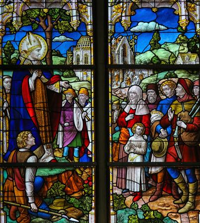 patron: MECHELEN, BELGIUM - JANUARY 31, 2015: Stained Glass window depicting Saint Rumbold, the patron saint of Mechelen, in the Cathedral of Saint Rumbold in Mechelen, Belgium.