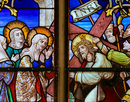 Mother Mary: MECHELEN, BELGIUM - JANUARY 31, 2015: Stained Glass window depicting Jesus and Mary on the Via Dolorosa, in the Cathedral of Saint Rumboldt in Mechelen, Belgium. Editorial