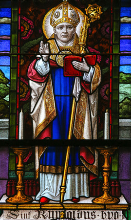 mitre: MECHELEN, BELGIUM - JANUARY 31, 2015: Stained Glass window depicting Saint Rumbold, the patron saint of Mechelen, in the Cathedral of Saint Rumbold in Mechelen, Belgium.