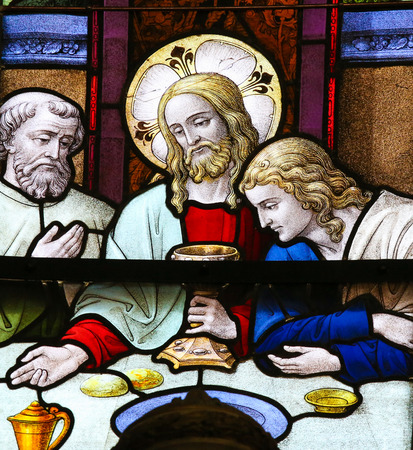 holy thursday: MECHELEN, BELGIUM - JANUARY 31, 2015: Stained Glass window depicting Jesus offering communion to His Apostles at the Last Supper, in the Cathedral of Saint Rumbold in Mechelen, Belgium.