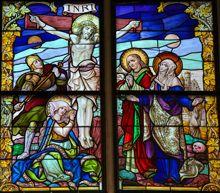 mary mother of jesus: MECHELEN, BELGIUM - JANUARY 31, 2015: Stained Glass window, depicting Jesus on the Cross on Good Friday, in the Cathedral of Saint Rumboldt in Mechelen, Belgium.