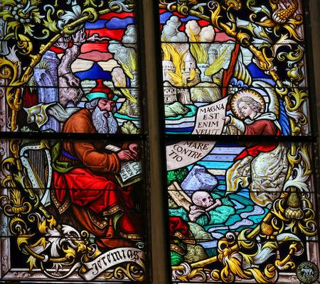 lamentation: MECHELEN, BELGIUM - JANUARY 31, 2015: Stained Glass window depicting the Prophet Jeremiah in the Cathedral of Saint Rumbold in Mechelen, Belgium.