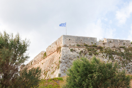 fortezza: Greek Flag at the Venetian Fortezza or Citadel in the city of Rethymno on the island of Crete, Greece, created in 1573.