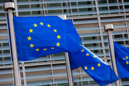 European flags in front of the Berlaymont building, headquarters of the European commission in Brussels. Standard-Bild