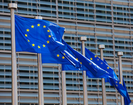 transnational: European flags in front of the Berlaymont building, headquarters of the European commission in Brussels. Stock Photo