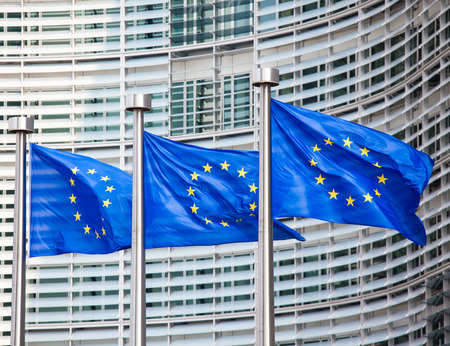 central european: European flags in front of the Berlaymont building, headquarters of the European commission in Brussels. Stock Photo
