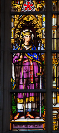 ix: BRUSSELS, BELGIUM - JULY 26, 2012: Stained Glass window depicting king Louis IX, commonly Saint Louis, Capetian King of France from 1226 until 1270, in the Cathedral of Brussels, Belgium.