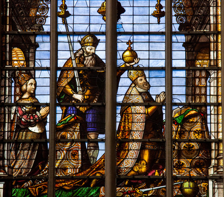 v alphabet: BRUSSELS, BELGIUM - JULY 26, 2012: Stained Glass window depicting Emperor Charles V  (16th Century) and his wife, Isabella of Portugal, in the Cathedral of Brussels, Belgium.