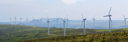 cleantech: ORTIGUEIRA, SPAIN - JULY 23, 2014: Panorama of a wind turbine farm in the Northern part of Galicia, Spain.