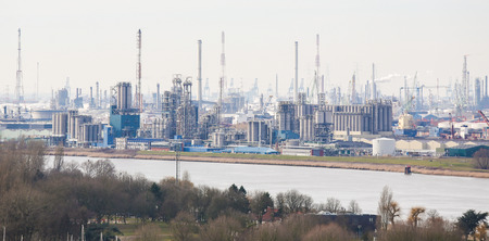 steam output: View on an oil refinery in the port of Antwerp, Belgium. Antwerp is the second largest port of Europe and a major petrochemical center.