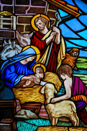 mother of jesus: OSTUNI, ITALY - MARCH 14, 2015: Stained glass window depicting a Nativity Scene and the Adoration of the Shepherds in the Church of Ostuni, Apulia, Italy. Editorial