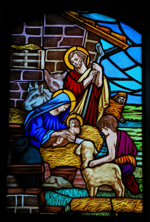 OSTUNI, ITALY - MARCH 14, 2015: Stained glass window depicting a Nativity Scene and the Adoration of the Shepherds in the Church of Ostuni, Apulia, Italy. Éditoriale