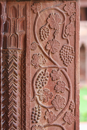 mughal architecture: Architectural detail of grapes carved into the wall of the palace of Fatehpur Sikri, ancient city founded by Mughal emperor Akbar, one of the best preserved collections of Indian Mughal architecture  in Agra, Uttar Pradesh, India Editorial