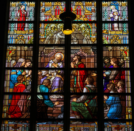 north brabant: S HERTOGENBOSCH, THE NETHERLANDS - JULY 23, 2011: Stained Glass Window depicting the Sacrament of Confession or Penance, with Pepin of Herstal confessing his sins to Saint Wiro, in Den Bosch Cathedral, North Brabant.
