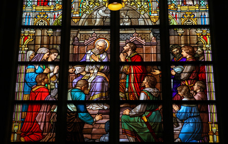 S HERTOGENBOSCH, THE NETHERLANDS - JULY 23, 2011: Stained Glass Window depicting the Sacrament of Confession or Penance, with Pepin of Herstal confessing his sins to Saint Wiro, in Den Bosch Cathedral, North Brabant.