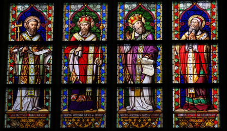 S HERTOGENBOSCH, THE NETHERLANDS - JULY 23, 2011: Stained Glass Window depicting Saint Basil of Caesarea, Gregory of Nazianzus, John Chrysostom and Athanasius of Alexandria in Den Bosch Cathedral, North Brabant. Editorial