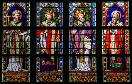 window glass: S HERTOGENBOSCH, THE NETHERLANDS - JULY 23, 2011: Stained Glass Window depicting Saint Basil of Caesarea, Gregory of Nazianzus, John Chrysostom and Athanasius of Alexandria in Den Bosch Cathedral, North Brabant. Editorial